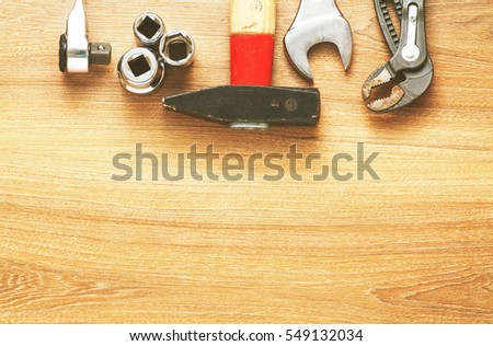 set of tools on wood background top view #549132034