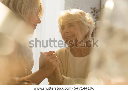 Caring woman supporting her happy old mother #549144196