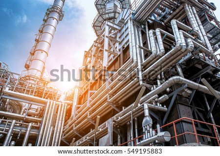 Close up Industrial view at oil refinery plant form industry zone with sunrise and cloudy sky Royalty-Free Stock Photo #549195883