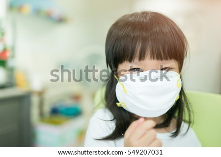 Little asian girl wearing a protective mask in school #549207031