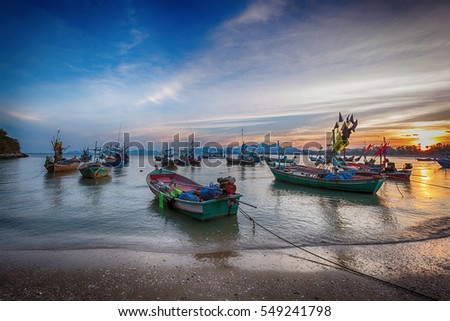 Fishing boat,waves and sunset with blue sky view in the evening. #549241798