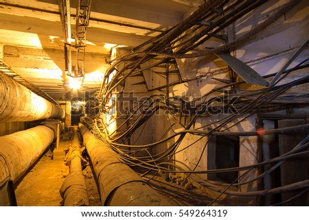 Underground tunnel of heating duct, place where homeless hide from winter cold #549264319