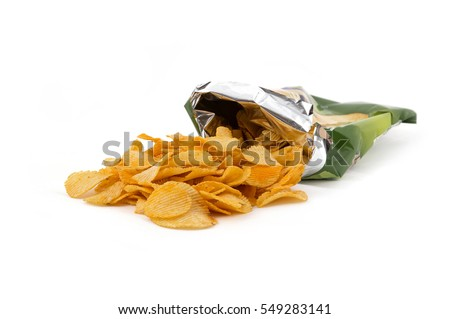 Potato crisp packet opened with crisps spilling out Royalty-Free Stock Photo #549283141