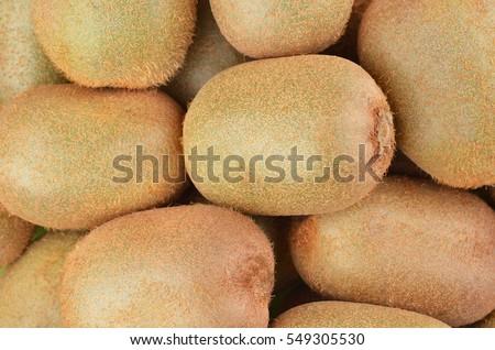 Green kiwi fruit (Actinidia deliciosa), close up shot #549305530