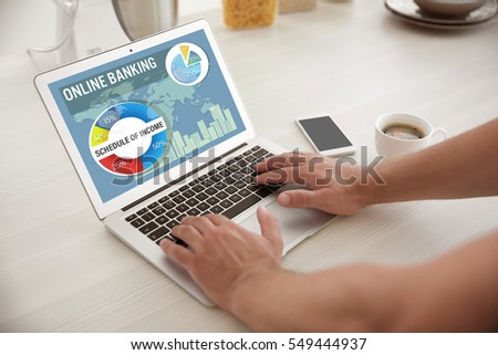 Online banking concept. Man using laptop #549444937
