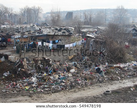Gypsy slum in Belgrade, Serbia, town city urban settlement, poverty, garbage or junkyard, houses and shacks made of wood or metal #549478198