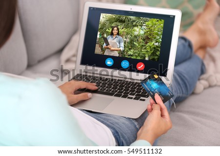 Video call and chat concept. Modern communication technology. Woman ordering flowers delivery online via laptop. #549511132