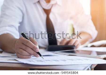Business concept, Businessman working on office desk, He was thinking about something for idea and make a Note something of Idea, Blurred background. #549541804