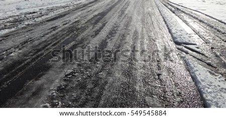 Icy road in winter Royalty-Free Stock Photo #549545884