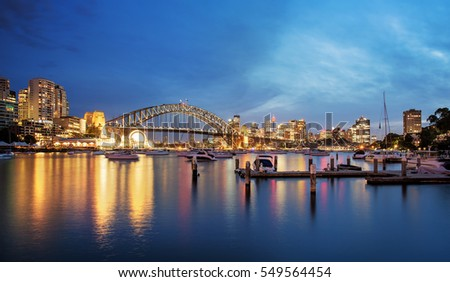 Sydney city skyline at night from Lavender Bay in long exposure Royalty-Free Stock Photo #549564454
