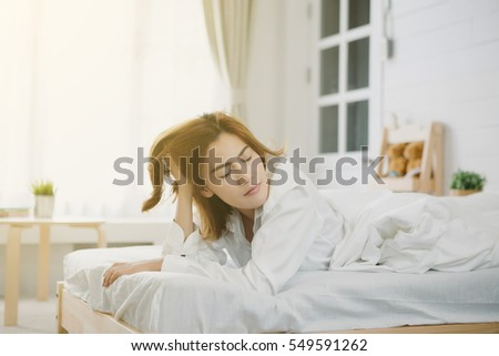 Young beautiful Asia woman hates waking up early in the morning. #549591262
