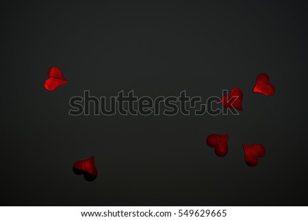 Red hearts and black background. Place your text #549629665