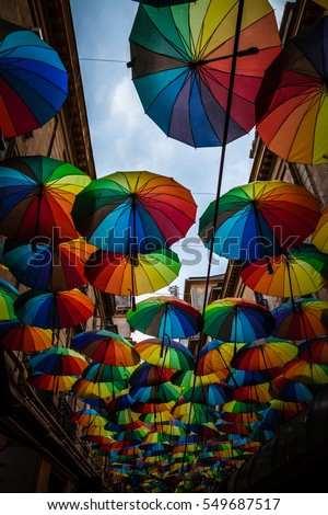 Color picture of colorful umbrella roof between buildings