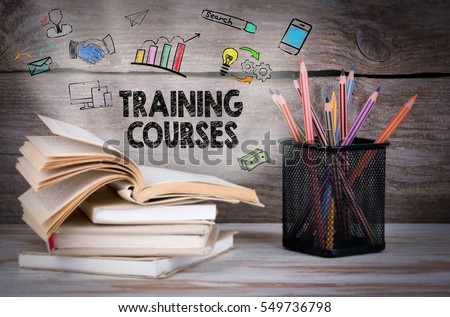 Training Courses, Business Concept. Stack of books and pencils on the wooden table Royalty-Free Stock Photo #549736798