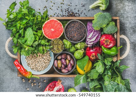 Vegetables, fruit, seeds, cereals, beans, spices, superfoods, herbs, condiment in wooden box for vegan, gluten free, allergy-friendly, clean eating and raw diet. Grey concrete background and top view #549740155