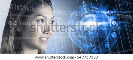 Smiling businesswoman looking away against black technology interface with glow #549769339