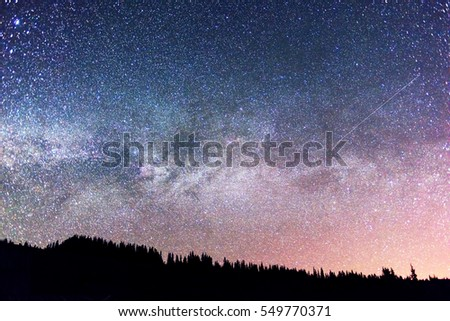 Starry sky above the earth scenic natural phenomena in the atmosphere, a colorful mix of colors and tones - the distant lights of the universe galaxy star clusters, nebulae and comets meteors