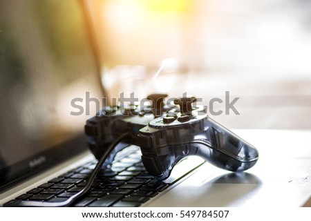 Video game controller isolated on the laptop.