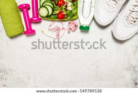 Healthy lifestyle, food, sport or athlete's equipment on bright background. Flat lay. Top view with copy space. Royalty-Free Stock Photo #549789538