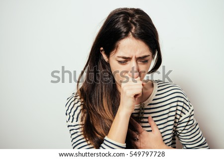Woman coughing Royalty-Free Stock Photo #549797728