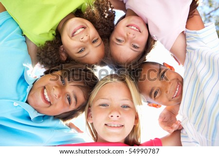 Group Of Children Looking Down Into Camera #54990787