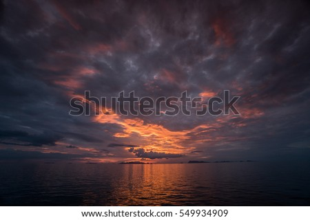 Colorful beautiful evening sunset above the sea in Thailand #549934909