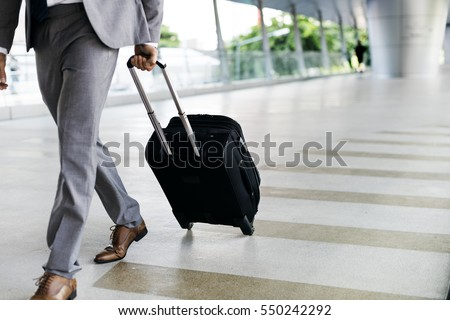Businessmen Hold Luggage Business Trip Royalty-Free Stock Photo #550242292