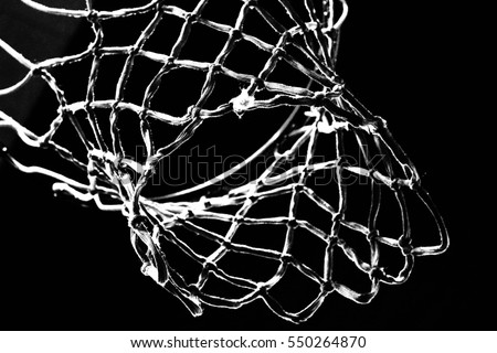 Empty Swooshing Basketball Net Close Up with Dark Background in Black and White #550264870