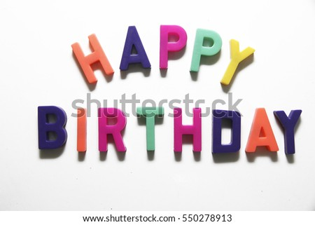 Colorful letter spelling Happy Birthday on white background.