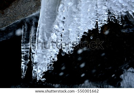Icicles and snow #550301662