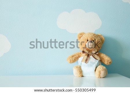 Toy bear dressed in diaper Royalty-Free Stock Photo #550305499
