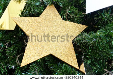 Gold star on a Christmas tree #550340266