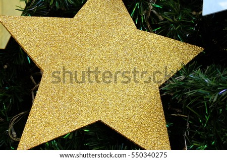 Gold star on a Christmas tree #550340275