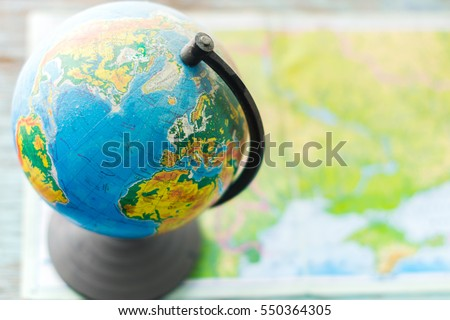 Globe on a table with blurred background