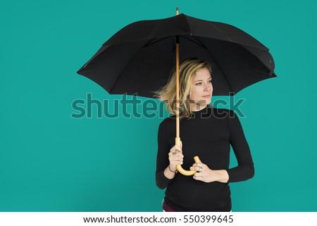Caucasian Lady Black Umbrella Concept #550399645