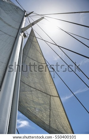 Low angle view of yacht sails and mast against sky #550400101
