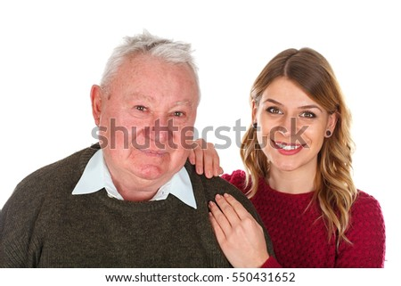Picture of a beautiful young woman posing with her grandfather - isolated background