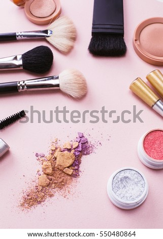 Colorful frame with various makeup products  #550480864