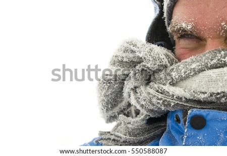 frozen man face in winter scene isolated on white background    Royalty-Free Stock Photo #550588087