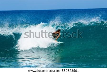 September 6, 2016 - Banzia Pipeline Oahu Hawaii. A surfer rides waves on Oahu's famous surf. #550828561