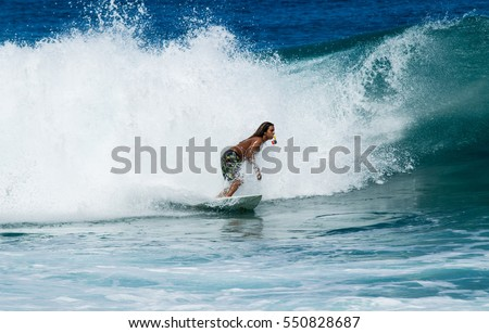 September 6, 2016 - Banzia Pipeline Oahu Hawaii. A surfer rides waves on Oahu's famous surf. #550828687