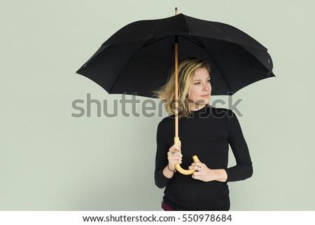 Caucasian Lady Black Umbrella Concept #550978684