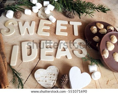 Sweet ideas wooden letters with chocolate with nuts. Ideas. Concept ideas. Winter sweet ideas on wooden background.  #551071690