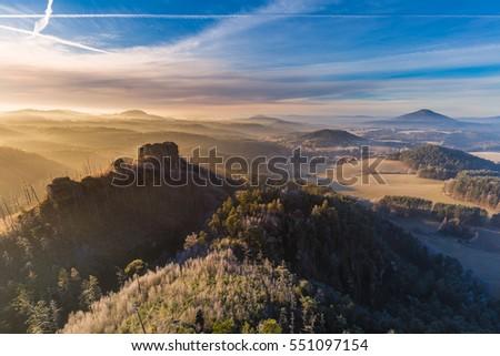 Winter morning sunrise over Jetrichovice, beautiful landscape, Bohemian Switzerland, Czech Republic #551097154