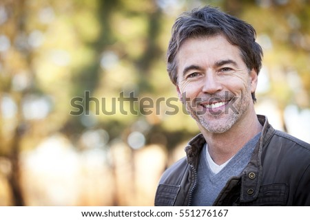 Handsome Mature Happy Man Smiling At The Camera.Outside. #551276167