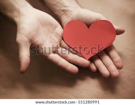 Valentine's card in her hands. favorite gift #551280991