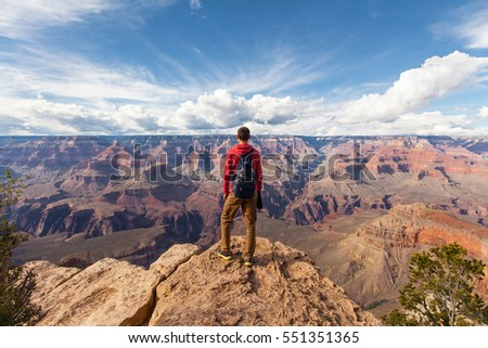 Travel in Grand Canyon, man Hiker with backpack enjoying view, USA Royalty-Free Stock Photo #551351365