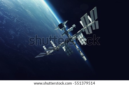 International Space Station over the planet Earth. Elements of this image furnished by NASA Royalty-Free Stock Photo #551379514
