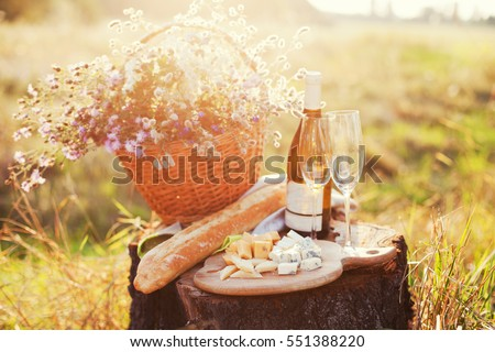 baguette, cheese board and wine #551388220