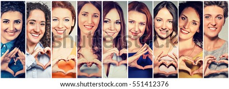 Multiethnic group of smiling cheerful happy women making heart sign with hands #551412376